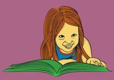读书的一个逗人喜爱的女孩 库存图片