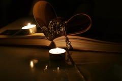 书袋手表蜡烛 图库摄影