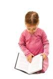 书逗人喜爱的女孩一点学龄前读取 库存图片