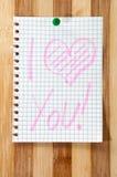 书面消息我爱你在作为背景的木板 免版税图库摄影