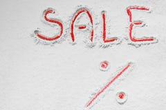 书面`在雪的销售% ` 库存图片
