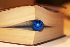 书页宏观视图 微笑玩具 免版税库存图片