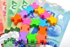 买与加拿大元的家庭概念 库存图片