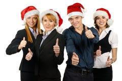 买卖人圣诞节新四个的帽子 免版税库存照片
