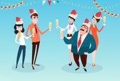 买卖人庆祝圣诞快乐和新年快乐办公室商人队圣诞老人帽子 库存图片