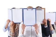 买卖人队拿着文件夹在白色背景隔绝的面孔附近 买卖人 免版税图库摄影