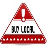 买在红色三角路标的本机 免版税库存图片