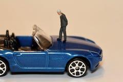 买在缩样的一辆汽车 免版税库存照片