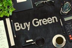 购买绿色-在黑黑板的文本 3d翻译 免版税库存图片