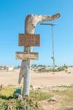乱扔废物的人的警报信号 库存照片