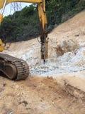 乱砍机器的岩石 图库摄影