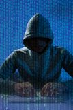 乱砍膝上型计算机的人佩带的巴拉克拉法帽 库存照片