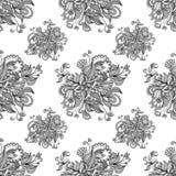 从乱画花的无缝的样式在灰色 免版税图库摄影