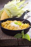 乳脂状的玉米用巴马干酪 库存图片