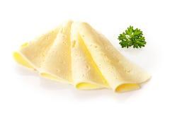 乳脂状的瑞士乳酪的安排 免版税库存照片