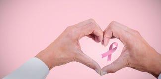 乳腺癌了悟丝带的综合图象 图库摄影