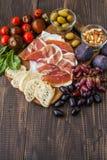 乳酪、熏火腿和梨 免版税库存照片