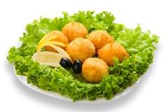 乳酪球开胃菜用橄榄 库存照片