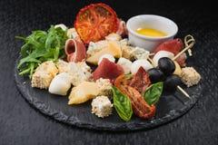 乳酪集合食物用熏火腿肉 免版税库存照片