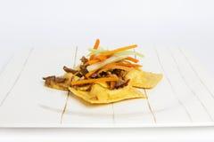 乳酪souce馄饨供食与白色蔬菜炖肉 免版税库存照片