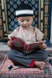 了解古兰经读 免版税库存图片