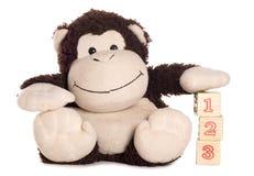 了解猴子软的玩具计数 库存照片