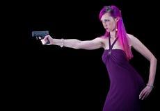 争取枪的妇女 免版税库存图片