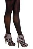 争论者凉鞋的妇女 免版税库存照片
