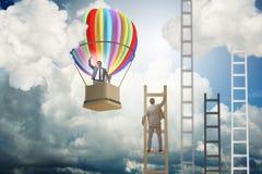 事业与商人的成就概念在气球和ladde 免版税库存照片