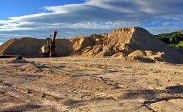 事业挖掘机老沙子 免版税库存照片