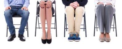 事业概念-商人的腿坐办公室椅子 库存照片