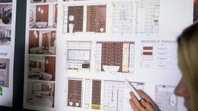 事务、起动、教育和人概念-创造性的建筑师队或学生有运作在办公室的图纸的 影视素材