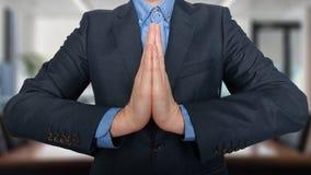 事务和办公室,人概念-祈祷的年轻buisnessman 图库摄影