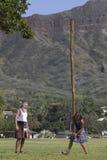 妇女的投棒步行 免版税库存照片