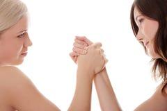 二个妇女现有量战斗 免版税库存照片