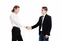 二个时兴的年轻人互相招呼 免版税库存照片