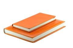 二个桔子笔记本。 大和小 免版税库存照片