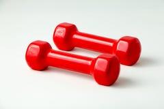 二个红色哑铃 免版税库存照片