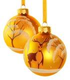 二个黄色圣诞节球 库存照片