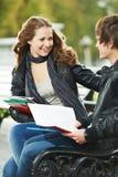 二位微笑的新学员户外 免版税库存照片