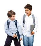 二位愉快的男小学生 免版税库存照片