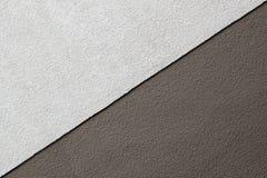 二口气在混凝土墙上的布朗纹理,三角形状 免版税库存照片