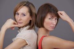 二名妇女纵向在工作室 图库摄影