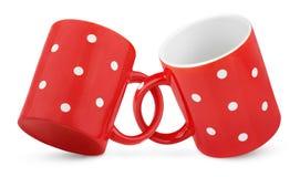 二耦合了红色圆点花样的布料杯子 免版税图库摄影