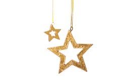 二金黄星形圣诞节装饰 免版税库存照片