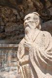 云南,中国- 2015年3月21日:在石宝山Moun的徐霞客雕象 库存照片