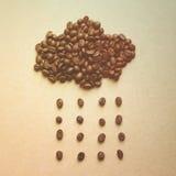 云彩和雨从咖啡豆 库存照片