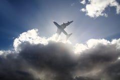 云彩和飞机 库存照片