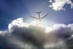 云彩和飞机 图库摄影