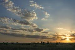 云彩围拢太阳 图库摄影